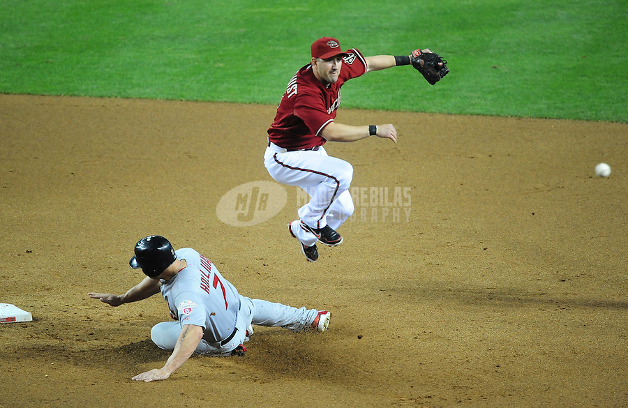 May 9, 2012; Phoenix, AZ, USA; Arizona Diamondbacks shortstop Willie Bloomquist throws to first to complete the double play after forcing out St. Louis Cardinals base runner Matt Holliday in the fifth inning at Chase Field. Mandatory Credit: Mark J. Rebilas-