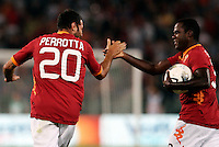 AS Roma midfielder Simone Perrotta, left, celebrates with teammate Fabio Simplicio, of Brazil, after scoring during an Europa League preliminary second leg football match between AS Roma and SK Slovan Bratislava, at Rome's Olympic stadium, Roma, 25 august 2011..UPDATE IMAGES PRESS/Riccardo De Luca