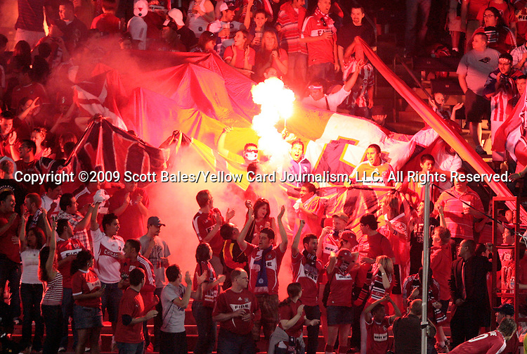 05 June 2009: Chicago fans in Section 8 burn flares while cheering for the team in the second half. The Houston Dynamo defeated the Chicago Fire 1-0 at Toyota Park in Bridgeview, Illinois in a regular season Major League Soccer game.