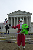 "Andrew Alexander of Charlottesville, Virginia is dressed in a ""Santa"" suit in front of the U.S. Supreme Court in Washington, DC prior to oral arguments in the Florida Recount case on December 11, 2000.<br /> Credit: Ron Sachs - CNP"
