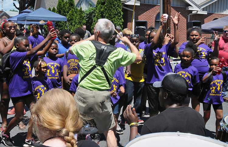 Jim Fitzmorris, the Director of the Percussion Orchestra of Kingston (POOK) leading the group in performing at the 11th Annual Mid-town Make a Difference Day Celebration on Franklin Street, in Kingston, NY on Saturday, June  18, 2016. Photo by Jim Peppler. Copyright Jim Peppler 2016.