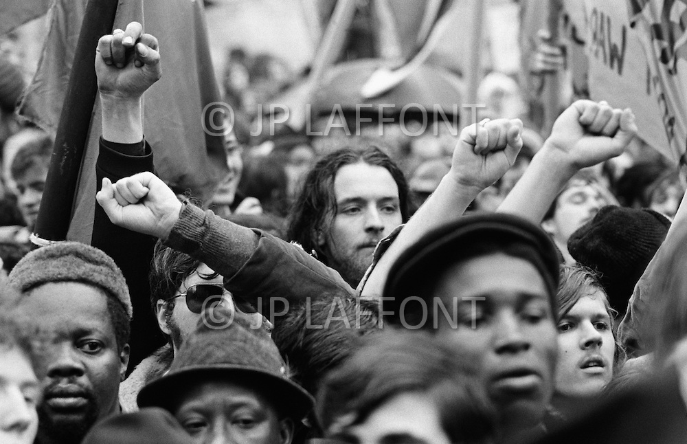 08 Apr 1969 --- Demonstrators in New York City protesting the Vietnam War, which as of this month has claimed more soldiers' lives than that of the entire Korean War. Last month, the United States began secret bombing campaigns of North Vietnamese and Vietcong bases in Cambodia. Rising their fist protestors support the Black Panthers Movement.<br />