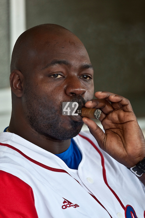 27 September 2009: Pedro Lazo of Cuba smokes a cigar prior to the 2009 Baseball World Cup gold medal game won 10-5 by Team USA over Cuba, in Nettuno, Italy.