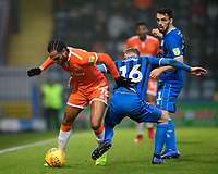 Blackpool's Nathan Delfouneso vies for possession with Rochdale's Matt Done<br /> <br /> Photographer Chris Vaughan/CameraSport<br /> <br /> The EFL Sky Bet League One - Rochdale v Blackpool - Wednesday 26th December 2018 - Spotland Stadium - Rochdale<br /> <br /> World Copyright &copy; 2018 CameraSport. All rights reserved. 43 Linden Ave. Countesthorpe. Leicester. England. LE8 5PG - Tel: +44 (0) 116 277 4147 - admin@camerasport.com - www.camerasport.com
