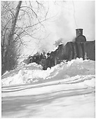 RGS #41 equipped with a large wedge pilot plow off the track while plowing snow with leased D&amp;RGW #319 pushing behind.<br /> RGS  Stapleton, CO  2/14/1949