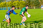 St. Senan's V Churchill: Churchill's Conor Daly wins the ball ahead of St. Senan;s Adrian Mahony in their county league game in Mountcoal on Saturday night last.