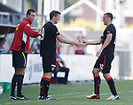Lee McCulloch hands returning substitute Jon Daly the captain's armband