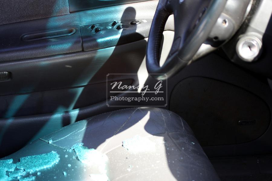 The broken window of a car after a break in