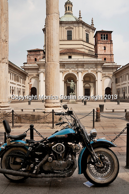Basilica of San Lorenzo with a motorcylce in the foreground in Milan, Italy