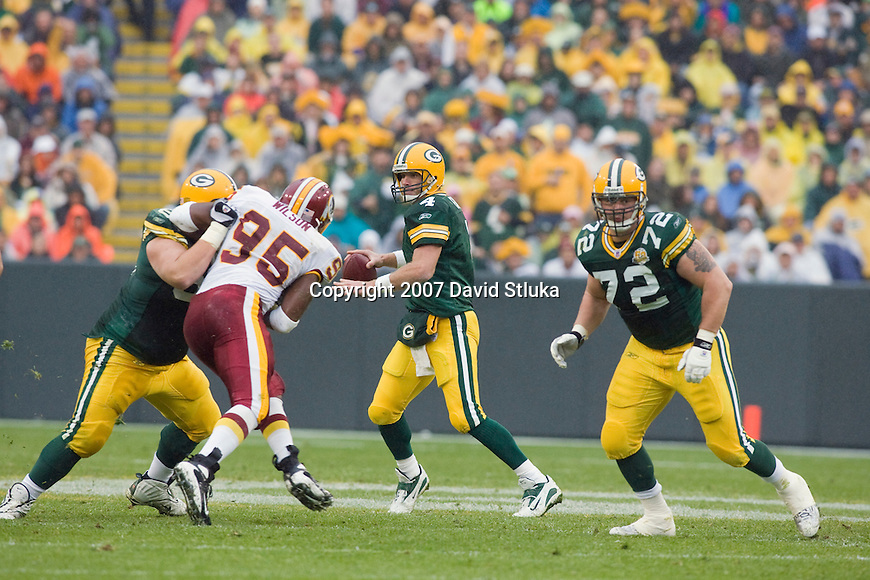 Quarterback Brett Favre #4 of the Green Bay Packers looks for a receiver during an NFL football game against the Washington Redskins on October 14, 2007 in Green Bay, Wisconsin. The Packers beat the Redskins 17-14. (Photo by David Stluka)