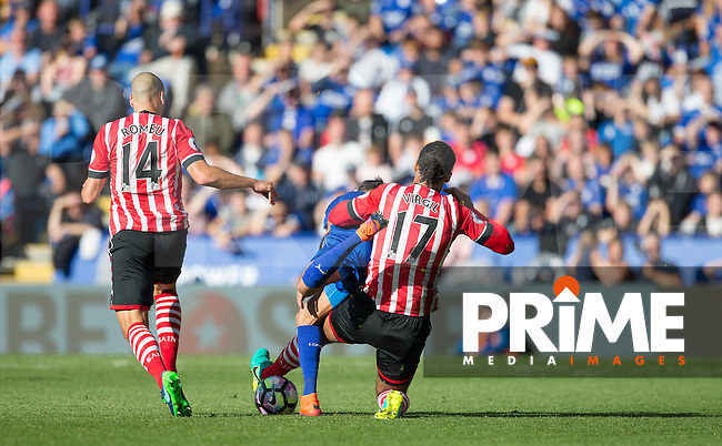 Virgil van Dijk of Southampton brings down Riyad Mahrez of Leicester City and receives a yellow card during the Premier League match between Leicester City and Southampton at the King Power Stadium, Leicester, England on 2 October 2016. Photo by Andy Rowland.