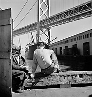 On the Waterfront: Longshoremen's lunch hour. San Francisco waterfront. California. February 1937.<br /> <br /> Photo by Dorothea Lange.
