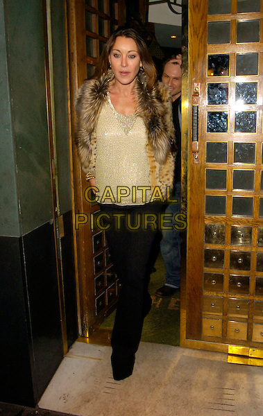 TAMARA MELLON.At The Ivy Restaurant, .London, England, 19th January 2007..full length fur gilet gold top black trousers.CAP/CAN.©Can Nguyen/Capital Pictures