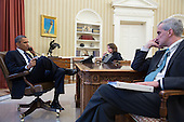 United States President Barack Obama talks on the phone with FBI Director Robert Mueller to receive an update on the explosions that occurred in Boston, in the Oval Office, April 15, 2013. Seated with the President are Lisa Monaco, Assistant to the President for Homeland Security and Counterterrorism, and Chief of Staff Denis McDonough. .Mandatory Credit: Pete Souza - White House via CNP
