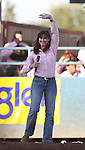 Lynne Heller waves to the crowd after singing the National Anthem at the Reno Rodeo on Friday, June 17, 2011 in Reno, Nev. .Photo by Cathleen Allison