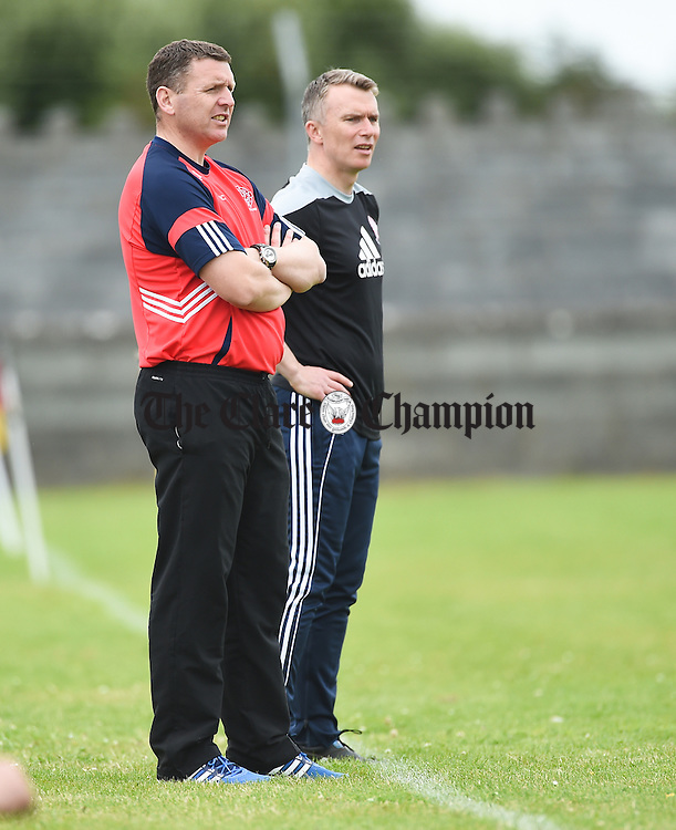 Eire OG selectors Peter Cosgrove and Paul Madden on the sideline against Ennistymon during their game in Miltown. Photograph by John Kelly.