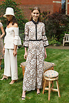 "Model poses in a shell corded lace fluted sleeve jumpsuit with grosgrain detail, from the Lela Rose Resort 2018 ""Garden Party"" collection in Jefferson Market Garden on June 7 2017, during Resort Fashion Week in New York City."
