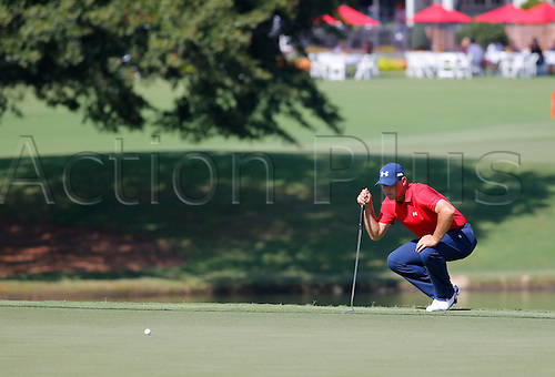 23.09.2016. Atlanta, Georgia, USA.  Gary Woodland lines up his putt during the second round of the Tour Championship at the East Lake Golf Club in Atlanta, GA.