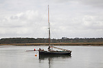 Yacht moored alone on the River Deben near Ramsholt, Suffolk, England