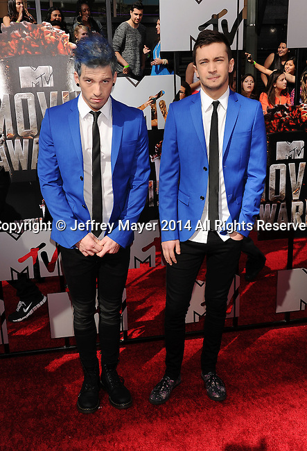 LOS ANGELES, CA- APRIL 13: Musicians Josh Dun (L) and Tyler Joseph of Twenty One Pilots attend the 2014 MTV Movie Awards at Nokia Theatre L.A. Live on April 13, 2014 in Los Angeles, California.