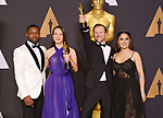 HOLLYWOOD, CA - FEBRUARY 26: (L-R) Presenter actor David Oyelowo, producer Joanna Natasegara, Director Orlando von Einsiedel, winners of the award for winners of the best Documentary Short Subject for 'The White Helmets' and presenter actress Salma Hayek pose in the press room during the 89th Annual Academy Awards at Hollywood & Highland Center on February 26, 2017 in Hollywood, California.