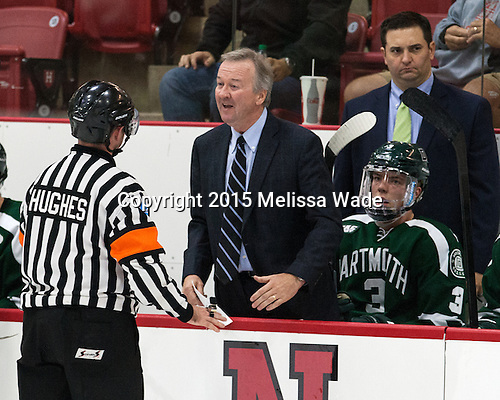 Marty Hughes listens to Bob Gaudet's (Dartmouth - Head Coach) concern. - The Harvard University Crimson defeated the Dartmouth College Big Green 5-2 to sweep their weekend series on Sunday, November 1, 2015, at Bright-Landry Hockey Center in Boston, Massachusetts. -