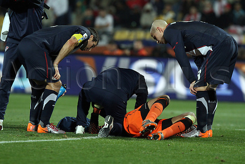 12 JUN 2010:  Tim Howard (USA)(ground) is attended to after being kicked in the arm.  The England National Team played the United States National Team played to a 1-1 tie at Royal Bafokeng Stadium in Rustenburg, South Africa in a 2010 FIFA World Cup Group C match.