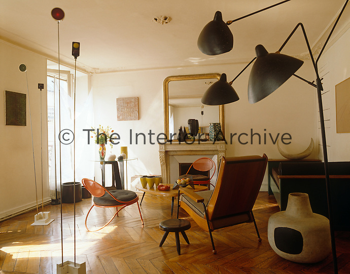 The unusual floor lamps, ceramics and furniture in this living room were all designed by Jean Prouve