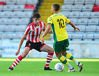 Lincoln City's Ellis Chapman blocks the run of Norwich City's Moritz Leitner<br /> <br /> Photographer Andrew Vaughan/CameraSport<br /> <br /> Football Pre-Season Friendly - Lincoln City v Norwich City - Tuesday 10th July 2018 - Sincil Bank - Lincoln<br /> <br /> World Copyright &copy; 2018 CameraSport. All rights reserved. 43 Linden Ave. Countesthorpe. Leicester. England. LE8 5PG - Tel: +44 (0) 116 277 4147 - admin@camerasport.com - www.camerasport.com