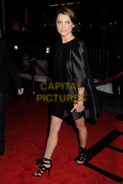 "KERI RUSSELL .""Extraordinary Measures"" Los Angeles Premiere held at Grauman's Chinese Theatre, Hollywood, California, USA..January 19th, 2010.full length black dress black straps ankle bow shoes silk satin clutch bag.CAP/ADM/BP.©Byron Purvis/AdMedia/Capital Pictures."