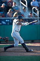 Tri-City Dust Devils shortstop Kelvin Alarcon (1) follows through on his swing during a Northwest League game against the Everett AquaSox at Everett Memorial Stadium on September 3, 2018 in Everett, Washington. The Everett AquaSox defeated the Tri-City Dust Devils by a score of 8-3. (Zachary Lucy/Four Seam Images)
