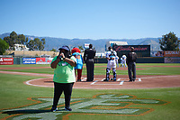 A young fan sings the National Anthem before a California League game between the Modesto Nuts and the Inland Empire 66ers on April 10, 2019 at San Manuel Stadium in San Bernardino, California. Inland Empire defeated Modesto 5-4 in 13 innings. (Zachary Lucy/Four Seam Images)