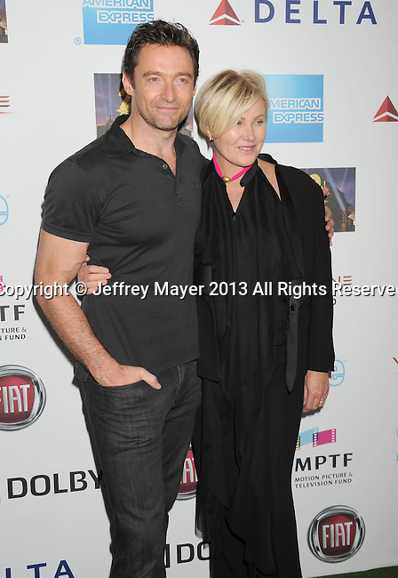 HOLLYWOOD, CA- OCTOBER 12: Actor Hugh Jackman and wife Deborra-Lee Furness arrive at Hugh Jackman: One Night Only Benefiting The Motion Picture & Television Fund at the Dolby Theater on October 12, 2013 in Hollywood, California.