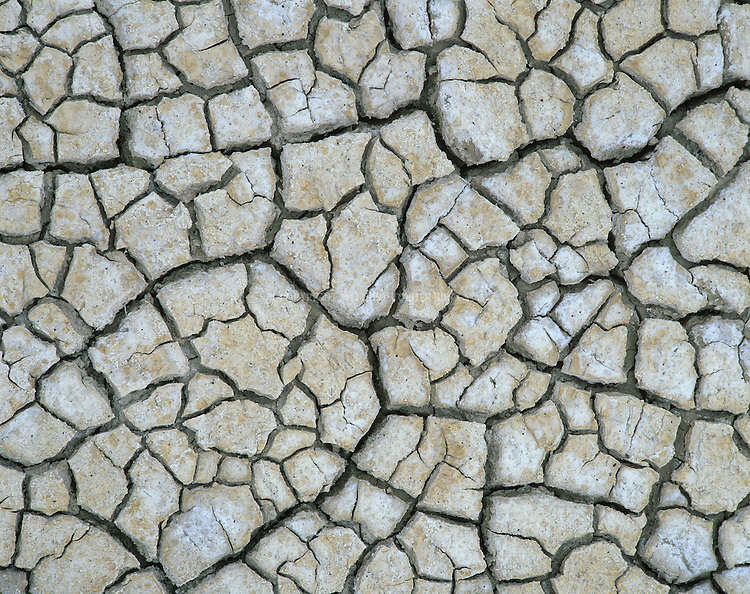 Desert heat and drought following spring rains give way to hardpan surfaces that crack as they dry creating interesting patterns. Taken near Trona Pinnacles, CA.