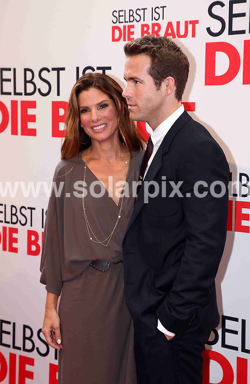 "**ALL ROUND PICTURES FROM SOLARPIX.COM**.**SYNDICATION RIGHTS FOR UK AND SPAIN ONLY**.Sandra Bullock presents her movie ""The Proposal"" in Munich, Germany. 29 June 2009..This pic: Sandra Bullock and Ryan Reynolds..JOB REF: 9372 CPR (Simon)       DATE: 29_06_2009.**MUST CREDIT SOLARPIX.COM OR DOUBLE FEE WILL BE CHARGED**.**ONLINE USAGE FEE GBP 50.00 PER PICTURE - NOTIFICATION OF USAGE TO PHOTO @ SOLARPIX.COM**.**CALL SOLARPIX : +34 952 811 768 or LOW RATE FROM UK 0844 617 7637**"
