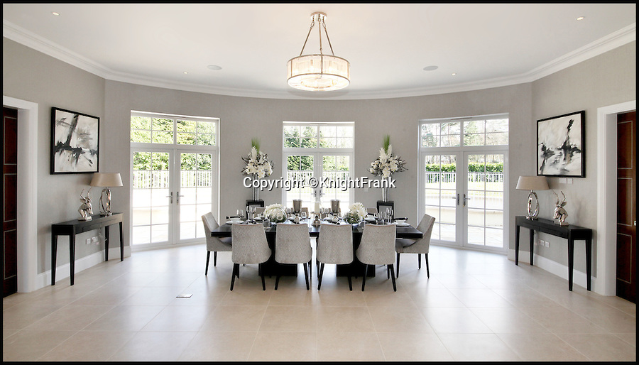 BNPS.co.uk (01202 558833)<br /> Pic: KnightFrank/BNPS<br /> <br /> Bolthole-in-one!<br /> <br /> Dining room.<br /> <br /> Golf fans will be green with envy - This brand new Palladian style pad comes with a fantastic view of the 17th green at exclusive Wentworth golf club in Surrey.<br /> <br /> But despite the &pound;6.75 million price tag you will still have to pass muster with the members and stump up a &pound;125,000 joining fee to become part of the world famous club.<br /> <br /> Greenside is part of the Wentworth Estate, one of the most expensive private estates in the country, which has the Wentworth Golf Club at its heart.<br /> <br /> The lucky buyer of this house can watch the world's best golfers battle it out for the European Tour's PGA Championship from the balcony overlooking the 17th green of the iconic West Course.<br /> <br /> The newly-built five-bedroom home, on the market with Knight Frank, has everything you could need, including an indoor swimming pool complex with a sauna and a spa.