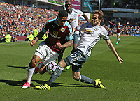 Burnley's Andre Gray battles with Manchester United's Daley Blind<br /> <br /> Photographer Stephen White/CameraSport<br /> <br /> The Premier League - Burnley v Manchester United - Sunday 23rd April 2017 - Turf Moor - Burnley<br /> <br /> World Copyright &copy; 2017 CameraSport. All rights reserved. 43 Linden Ave. Countesthorpe. Leicester. England. LE8 5PG - Tel: +44 (0) 116 277 4147 - admin@camerasport.com - www.camerasport.com