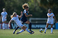 Sanford, FL - Saturday Oct. 14, 2017:  A Courage player tries the dribble away from a sliding challenge during a US Soccer Girls' Development Academy match between Orlando Pride and NC Courage at Seminole Soccer Complex. The Courage defeated the Pride 3-1.