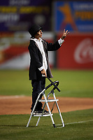 """A young fan leads the singing of """"Take Me Out to the Ball Game"""" between innings of a California League game between the Visalia Rawhide and the Lancaster JetHawks at The Hangar on May 17, 2018 in Lancaster, California. Lancaster defeated Visalia 11-9. (Zachary Lucy/Four Seam Images)"""