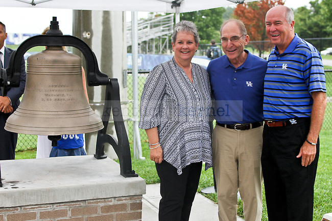 "University of Kentucky President Eli Capilouto poses for a picture next to the new ""Wildcat Victory Bell"" during the dedication ceremony of the Wendell and Vickie Bell Soccer Complex in Lexington, Ky., on Sunday, August 31, 2014. Photo by Jonathan Krueger 