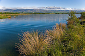 The irrigation reservoir  Lake Opuha near Fairlie with the Sherwood range in the distance,Mackenzie District, Canterbury, South Island, New Zealand.