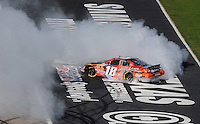 Nov. 7, 2009; Fort Worth, TX, USA; NASCAR Nationwide Series driver Kyle Busch celebrates after winning the O'Reilly Challenge at the Texas Motor Speedway. Mandatory Credit: Mark J. Rebilas-