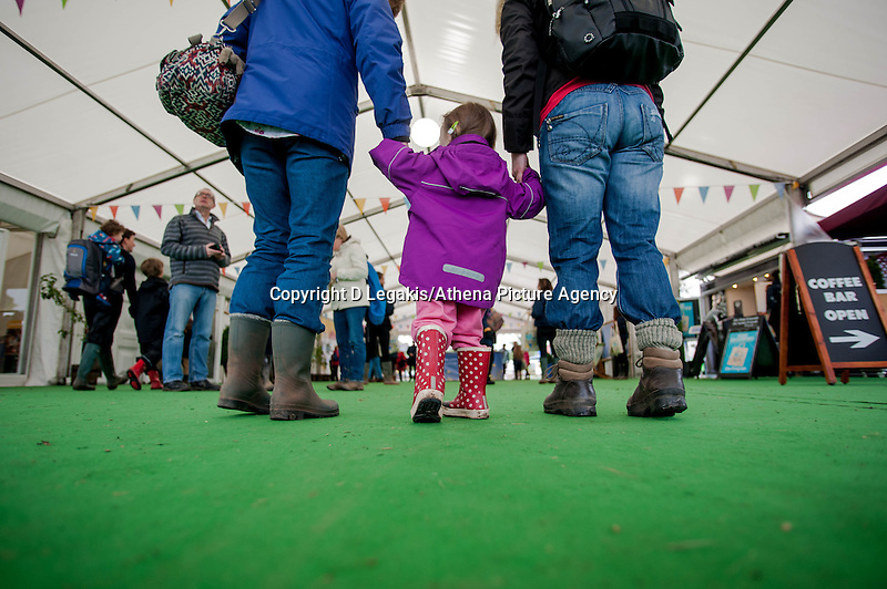 Thursday  29 May 2014, Hay on Wye, UK<br /> Pictured: A Family walk hand in hand through the Hay festival <br /> Re: The Hay Festival, Hay on Wye, Powys, Wales UK.
