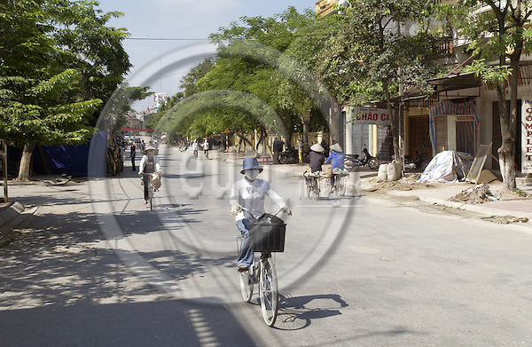 Bac Ninh-Vietnam-Viet Nam - 27 July 2005---Low traffic / bicycles at noon in a main street of Bac Ninh ---traffic, transport, woman---Photo: Horst Wagner/eup-images