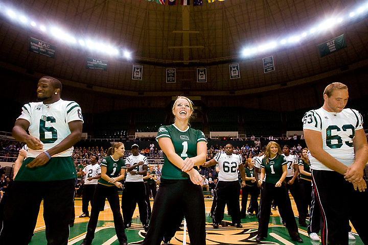 Laura Sobeck of the Ohio dance Team, center, leads her team and the football team in a dance  during the Yell Like Hell pep rally in the Convocation Center on Friday, October 12, 2007. She is joined up front by Joshua Abrams, left, and Marcus O'Hara,..Photo by Kevin Riddell
