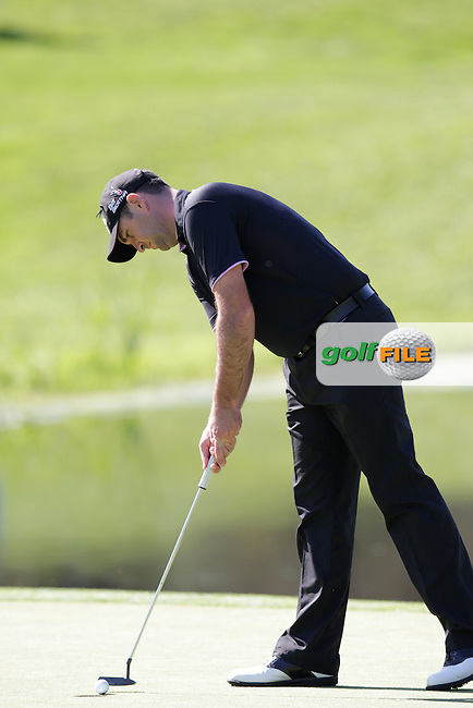 Jack Doherty (SCO) putts on the 4th green during Thursday's Round 1 of the 2014 Open de Espana held at the PGA Catalunya Resort, Girona, Spain. Wednesday 15th May 2014.<br /> Picture: Eoin Clarke www.golffile.ie