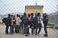 A police officer lines up illegal immigrants who are about to be released and board a bus that will take them to Athens, at the detention centre in Fylakio. According to UNHCR, 38,992 immigrants arrived in Greece in the first 10 months of 2010, whereas in 2009 the number was only 7,574.