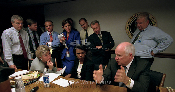 "RC:  PEOC room meetings on day of terrorist attacks.  RESTRICTED: DO NOT PRINT WITHOUT APPROVAL OF DAVID BOHRER..Immediately after the Sept. 11 terrorist attacks, Vice President Dick Cheney and senior staff gathered in the President's Emergency Operations Center. White House staff collected and discussed information as the day unfolded and they kept in contact with the President.  Photographed are Counselor Karen Hughes (seated left), National Security Advisor Dr. Condoleezza Rice (seated right), Deputy Chief of Staff Josh Bolten (far left), Director of Media Affairs Tucker Eskew, Assistant to the President Nick Calio, Counselor to the Vice President Mary Matalin, Chief of Staff for the Vice President Lewis Libby, and Director of the National Economic Council Larry Lindsey (right)...Released (to Washington Post 6.6.07): Vice President Dick Cheney and senior staff gather in the Presidential Emergency Operations Center immediately following the terrorist attacks Sept. 11, 2001. Photographed are Counselor Karen Hughes (seated left), National Security Advisor Dr. Condoleezza Rice (seated right), Deputy Chief of Staff Josh Bolten (far left), Director of Media Affairs Tucker Eskew, Assistant to the President Nick Calio, Counselor to the Vice President Mary Matalin, Chief of Staff for the Vice President Lewis Libby, and Director of the National Economic Council Larry Lindsey (right). .WEB..Released to NIGHTLINE 111203, David Wargin, American Legislative Exchange Council and National Journal..Released to Bush/Cheney '04 for Mary Matalin interview with MSNBC 8.20.04..Released to National Geographic for a children's book ""Our Country's Presidents"" 10.2.04..RELEASED TO: CBC TELEVISION CANADA.  . WEST WING JUMBO .WEB."
