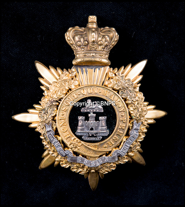 BNPS.co.uk (01202 558833)<br /> Pic: TomWren/BNPS<br /> <br /> The Essex Regiment.<br /> <br /> A stunning collection of military badges amassed by one man has been unearthed to remember the lost regiments of the British Army.<br /> <br /> More than 800 brass badges recovered from old pith helmets, peaked caps and military tunics were amassed by the late collector over a lifetime.<br /> <br /> Many of the insignia date back to the Victorian era and represent regiments which no longer exist or which have been amalgamated, having either been decimated in the First World War or wiped out by government cuts.<br /> <br /> The collection is being sold by Charterhouse Auctioneers of Dorset.