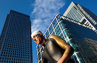 30 JUN 2011 - LONDON, GBR - Steven Worthington makes his way to the start of the first men's super sprint elimination heat at the GE Canary Wharf Triathlon (PHOTO (C) NIGEL FARROW)
